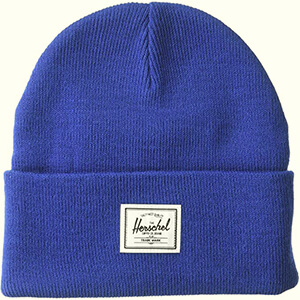 Folded Herschel beanie with a white tag
