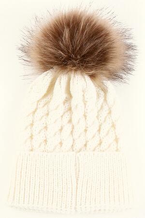 White knit baby girl's beanie hat with brown pom pom
