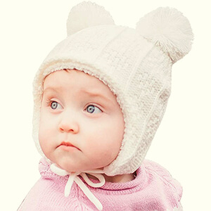 White baby girl's beanie hat with earflaps and double pom poms