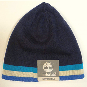 Navy blue reversible Timberland beanie with two tonnes of the blue and white stripes at the bottom