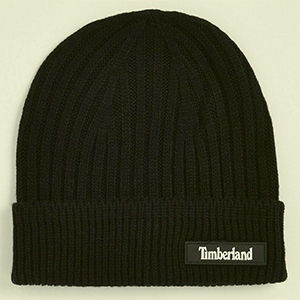 Cuffed black Timberland beanie with a leather script tag on the side