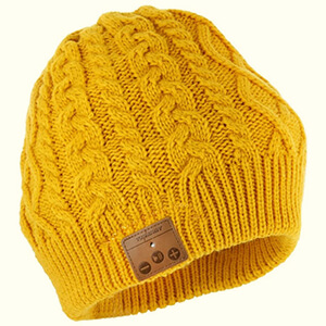 Winter beanie with built-in headphones with a leather panel display