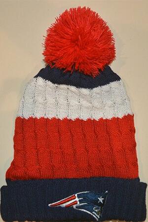 Blue Patriots beanie with wide red and white stripe and pom pom