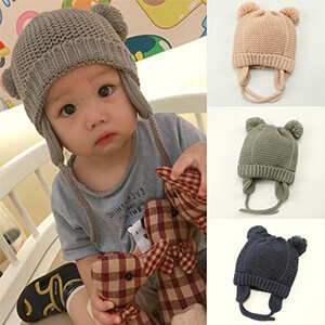 Gray knit infant boy's beanie with ear flaps and pom poms