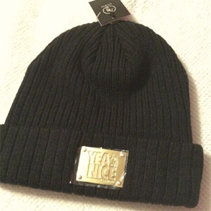 Black Yea.Nice beanie with gold metal logo tag