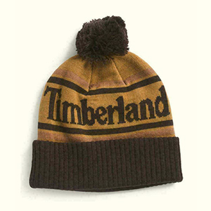 Two tonnes of the brown with black stripes folded Timberland beanie with pom-pom