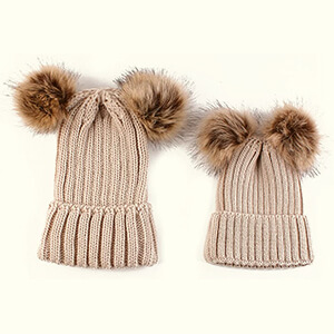 Knit matching family beanies with double pom-poms
