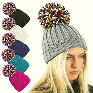 Winter girl's beanie with colorful oversized pom-pom