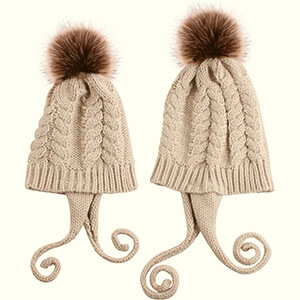 Winter matching family beanies with curled tassels on earflaps