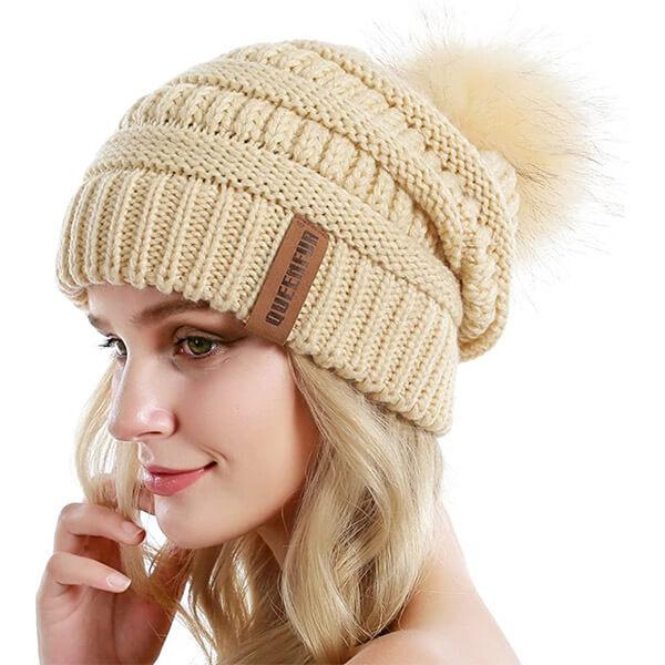 Knit slouchy beanie with faux fur pom pom